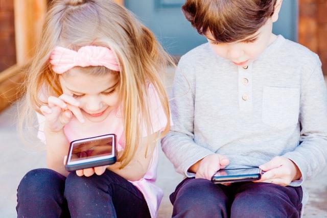 girl and boy on phones