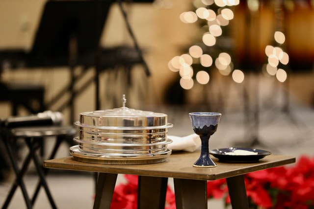 communion cup and plate set at altar