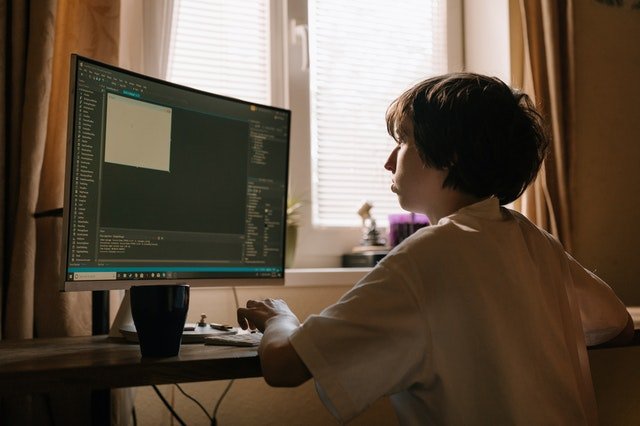 child on computer programming