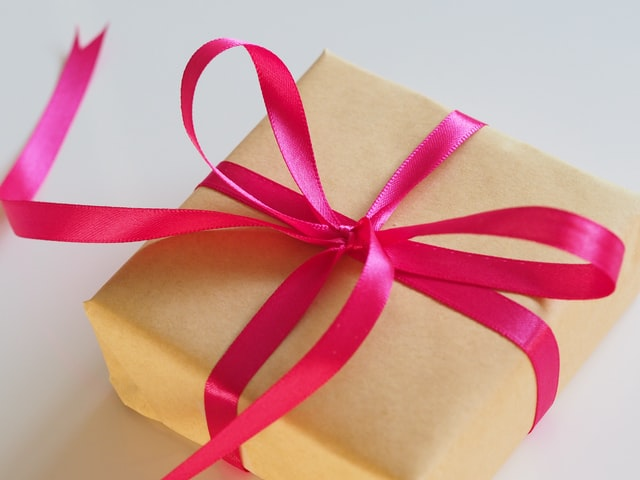 brown gift box with red ribbon