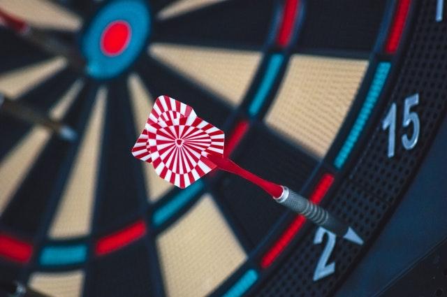 dart board with dart on outside
