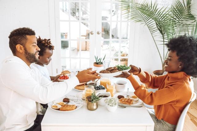 happy family at breakfast table