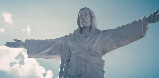 statue of Jesus with blue sky in background
